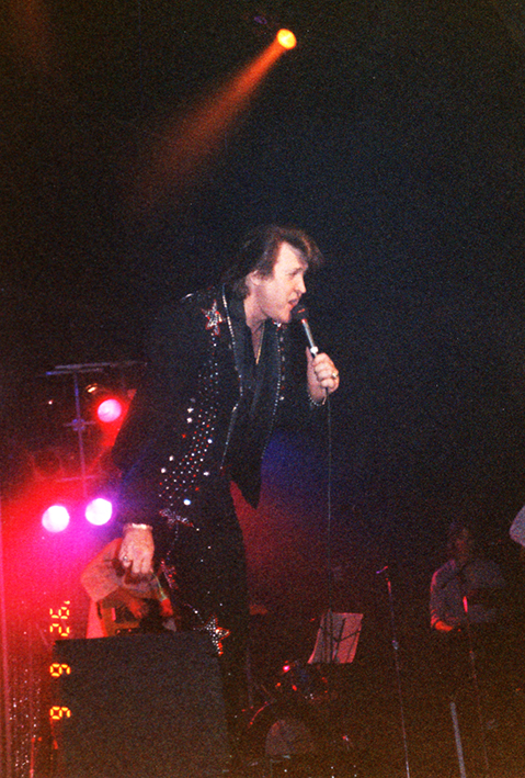On stage with suit, June 6, 1992