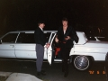 Exciting a limo with suit on his arm, June 6, 1992