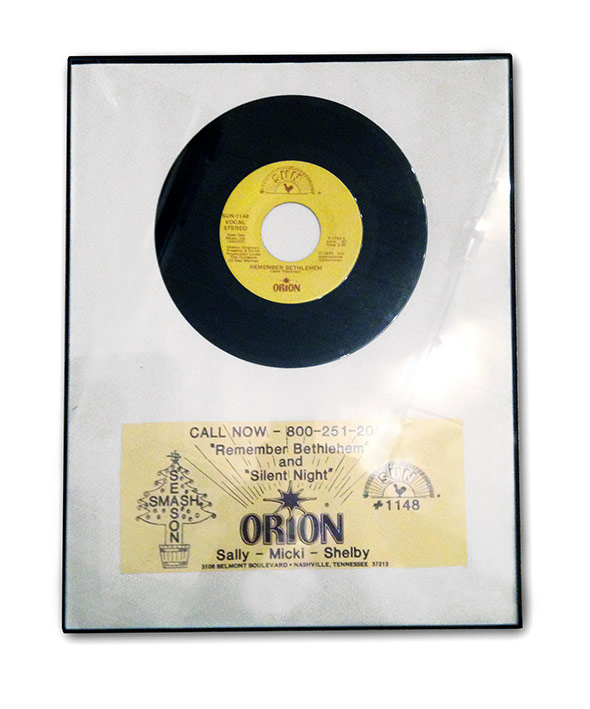 Framed single from Orion's office