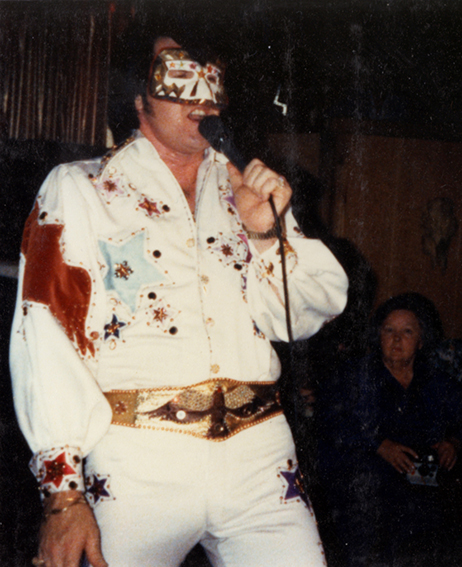 Wearing suit on stage, November 1979
